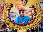 """29 AUGUST 2105 - KO KRET, NONTHABURI, THAILAND:   A musician preforms for dancers performing a scene from the """"Ramakien,"""" the Thai version of the Ramayana, on Ko Kret. Ko Kret is a small island in the Chao Phraya River in Nonthaburi province north of Bangkok. It is some 2 km long and 1 km wide. It has seven main villages, the largest and most populous being Ban Mon. Ko Kret was created in 1722 when a canal was dug in the Chao Phraya River to bypass a bend. Most of the people on the island are ethnically Mon, from the hills of western Thailand and eastern Myanmar (Burma). The island is popular as a weekend daytrip from Bangkok. The island is famous for the Mon style pottery made on the island.   PHOTO BY JACK KURTZ"""