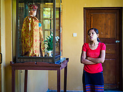 19 NOVEMBER 2017 - HWAMBI, YANGON REGION, MYANMAR: A woman prays in the portico during mass at Sacred Heart's Catholic Church in Hwambi, about 90 minutes north of Yangon. More than 500 people attend mass at Sacred Heart's, and the sanctuary was full. Catholics in Myanmar are preparing for the visit of Pope Francis. He is coming to the Buddhist majority country November 27-30. There about 500,000 Catholics in Myanmar, about 1% of the population. Catholicism was originally brought to what is now Myanmar more than 500 years ago by Portuguese missionaries and traders.    PHOTO BY JACK KURTZ