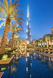 View of Burj Khalifa and Souq al Bahar at night in Downtown Dubai in United Arab Emirates