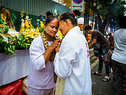 30 SEPTEMBER 2017 - BANGKOK, THAILAND: Women finish praying together before the Navratri parade in Bangkok. Navratri is a nine night (10 day) long Hindu celebration that marks the end of the monsoon and honors of the divine feminine Devi (Durga). The festival is celebrated differently in different parts of India, but the common theme is the battle and victory of Good over Evil based on a regionally famous epic or legend such as the Ramayana or the Devi Mahatmya. Navratri is celebrated throughout Southeast Asia in communities that have large Hindu population. Bangkok's celebration of Navratri was subdued this year because Thais are still mourning the death of Bhumibol Adulyadej, the Late King of Thailand, who died on October 13, 2016.      PHOTO BY JACK KURTZ