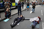 Extinction Rebellion activists locked on as disruption begins and protesters block 12 sites around Westminster on 7th October 2019 in London, England, United Kingdom. Extinction Rebellion is a climate change group started in 2018 and has gained a huge following of people committed to peaceful protests. These protests are highlighting that the government is not doing enough to avoid catastrophic climate change and to demand the government take radical action to save the planet.