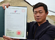 MAANSHAN, CHINA - APRIL 27: (CHINA OUT) <br /> <br /> Homemade Submarine <br /> <br /> Zhang Shengwu shows the national patent for his homemade submarine at Zhangdu village on April 27, 2016 in Maanshan, Anhui Province of China. 51-year-old Zhang Shengwu, who built a dock and sold building materials, used over 5,000 yuan (about 771 USD) make a submarine in two month in Maanshan. The 6-meter-long, 2 tons submarine was powered by a tricycle motor, and had no Oxygen supply system. The submarine could dove over one meter under water, and Zhang had obtained national patent for it on February in 2016.<br /> ©Exclusivepix Media