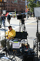 Associated Press team set up outside the 14th Street Apple Store in New York to report on the death of Steve Jobs