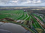 Nederland, Zuid-Holland, Nieuwerkerk aan den IJssel, 25-02-2020; Groenendijk tussen Klein en Ver Hitland. Bij de dewatersnoodvan 1 februari1953 dreigde de rivierdijk hier door te breken (direct boven midden strekdam)  en zouden de polders tot aan Den Haag, (aan de verre horizon) ondergelopen zijn (met rampzalige gevolgen). Doordat het binnenvaartschip 'De twee gebroeders' in het gat van de dijk gevaren werd is de ramp voorkomen.<br /> <br /> luchtfoto (toeslag op standard tarieven);<br /> aerial photo (additional fee required)<br /> copyright © 2020 foto/photo Siebe Swart