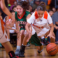 120513       Cable Hoover<br /> <br /> Wingate Bear Cheyanne Begay (21) and Gallup Bengal Raelynn Yazzie (20) chase down a loose ball during the first round of the John Lomasney Girls Basketball Tournament at Gallup High School Thursday.