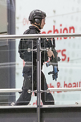 © Licensed to London News Pictures . 14/02/2020. Manchester, UK. Armed police are seen in the Arndale Centre during the exercise . Police stage a major terrorist incident as a training exercise , at the Arndale Shopping Centre in Manchester City Centre . Residents have been advised not to be concerned by the sound of loud bangs that might be heard overnight from within the closed-off venue . Photo credit: Joel Goodman/LNP