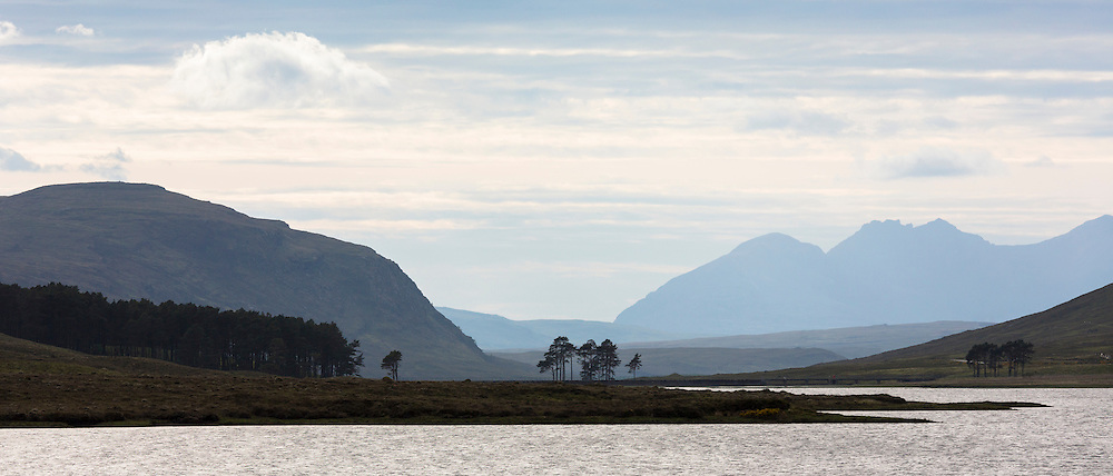 Breathtaking Scottish landscape with loch and mountains in the western hIghlands of Scotland