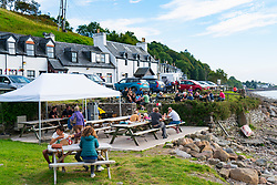 View of pub garden at Applecross Village a popular stop on the North Coast 500 tourist road trips around the north coast of Scotland.