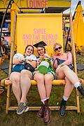 Henham Park, Suffolk, 19 July 2019. A recent graduate celebrates with friends - The 2019 Latitude Festival.
