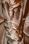 Zebra Slot Canyon, Grand Staircase-Escalante National Monument, Utah, USA. From Hole-in-the-Rock Road, hike east on a well-trodden but unmarked path, 5 miles round trip with 450 feet total gain to Zebra Slot.