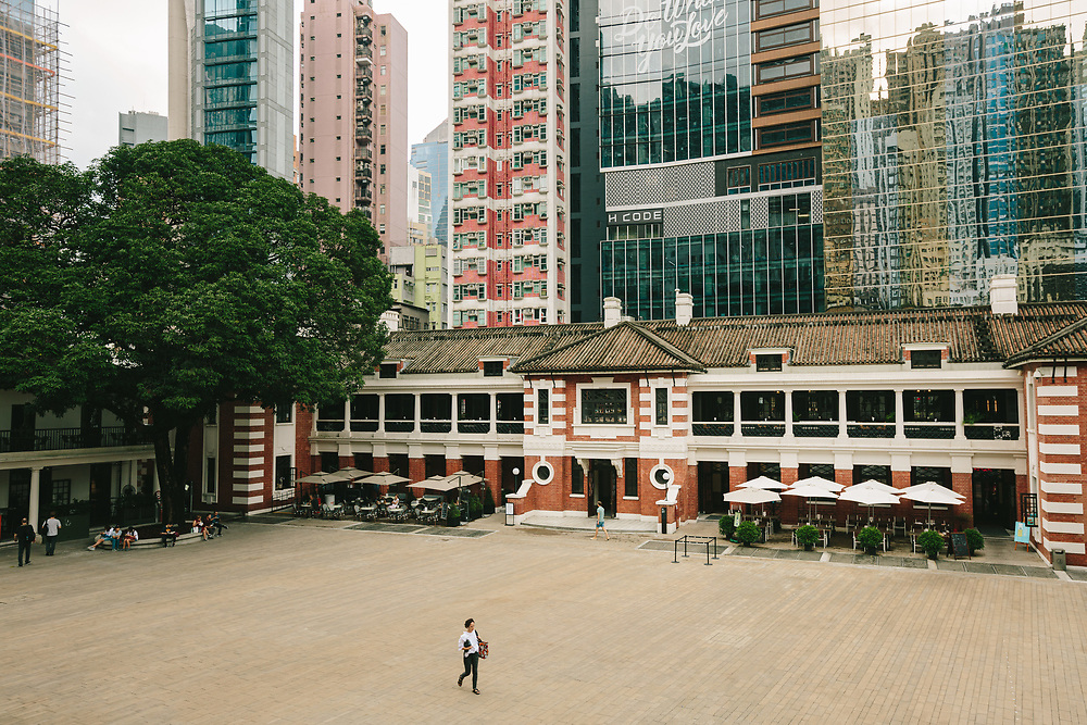 People visit Tai Kwun Centre for Heritage and Arts, a compound comprised of several recently renovated colonial-style buildings in Central, Hong Kong Island, on October 14, 2019. Colloquially known as Tai Kwun, or 'big station' – the Arts Centre was opened to the public in 2018, following a multi-year renovation, restoration, and conservation project which saw the overhaul of the compound built by the British between the mid-19th and 20th centuries. The complex included the British Central Police Station, court buildings, and Victoria Prison, the city's first jail.