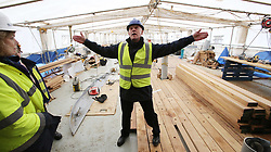 Photo/Paul McErlane© Licensed to London News Pictures. 28/04/2016. Belfast County Antrim, Northern Ireland, UK. HMS Caroline's restoration is the biggest World War One project of the century. Funded by Heritage Lottery Fund and supported by DETI, the Portsmouth-based National Museum of the Royal Navy undertook the restoration project three years ago. It will be completed in time for the centenary of the Battle of Jutland on May 31 2016. National Museum of Royal Navy Chief of Staff Captain John Rees explains historical facts regarding forward section of HMS Caroline.  Photo credit : Paul McErlane/LNP