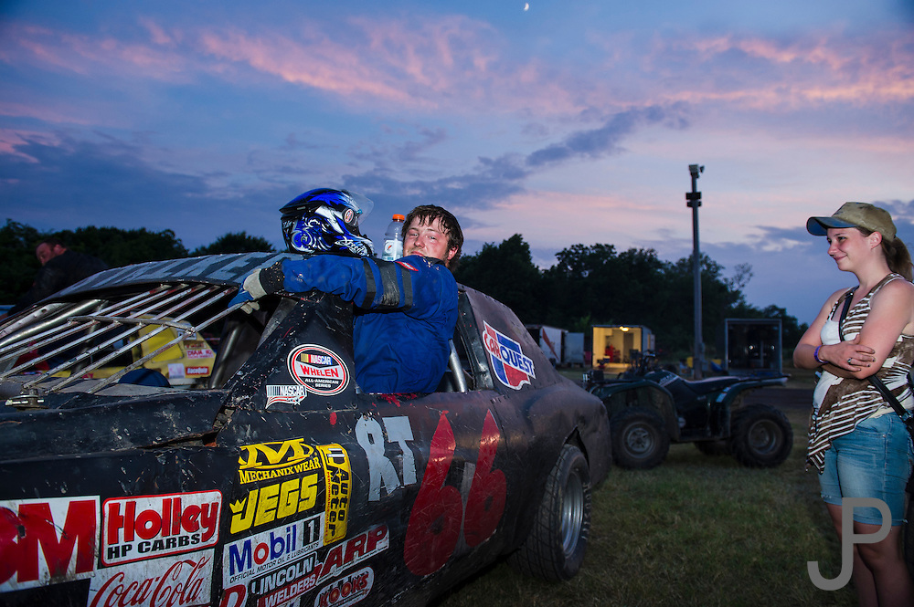Pure Stock racer Jeremy Lucas climbing out of his RT 66 race car after winning 4th place at Salina High Banks Speedway.