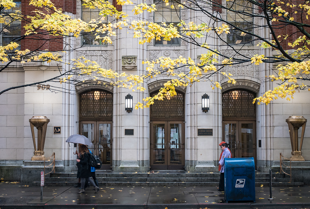 Fall leaves and passersby outline the U.S. Post Office building near Pioneer Square.