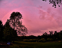 Rainbow at Sunset. Backyard spring nature in New Jersey. Composite of three images taken with a Fuji X-T1 Camera and 16-55 mm  f/2.8  zoom lens (ISO 800, 16 mm, f/2.8, 1/60 sec). Raw image processed with Capture One Pro and AutoPano Giga Pro.