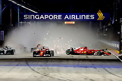 September 17, 2017 - Singapore - Kimi Raikkonen's damaged Ferrari, right, slides out of control after his teammate Sebastian Vettel, center, squeezed he and Red Bull's Max Verstappen at the start of the Formula One Grand Prix of Singapore. All three drivers retired from the race on the first lap. (Credit Image: © Hoch Zwei via ZUMA Wire)