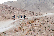 A group hiking in the Negev Desert Photographed in Nahal  Tzeelim [Tze'eelim Stream], Negev Desert, Israel  in December