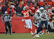 KANSAS CITY, MO - NOVEMBER 24:  Safety Kendrick Lewis #23 of the Kansas City Chiefs reaches back for a tipped ball, as tight end Antonio Gates #85 of the San Diego Chargers looks on during the second half on November 24, 2013 at Arrowhead Stadium in Kansas City, Missouri.  San Diego won 41-38. (Photo by Peter Aiken/Getty Images) *** Local Caption *** Kendrick Lewis;Antonio Gates