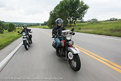 Sharon Jacobs riding her 1936 Harley-Davidson VLH along with Cris Sommer Simmons on her 1934 Harley-Davidson VD during Stage 6 of the Motorcycle Cannonball Cross-Country Endurance Run, which on this day ran from Cape Girardeau to Sedalia, MO., USA. Wednesday, September 10, 2014.  Photography ©2014 Michael Lichter.
