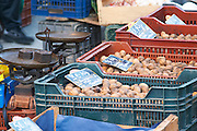 Walnuts for sale in plastic crates baskets at a market stall at the market in Bergerac Dordogne France