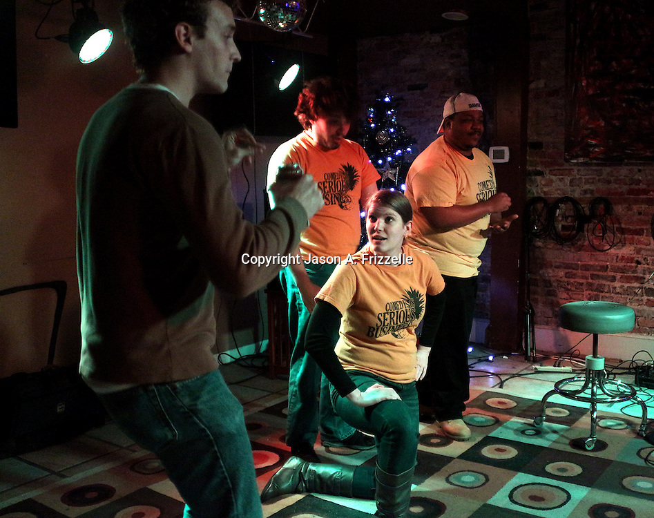 Zach Pappas, left Brett J. Young, back-center, Jordan Mullaney, front-center and Brick Jackson perform during Pineapple Shaped Lamps' premiere party for Sketch 22, a show that airs on the Cape Fear CW. (Jason A. Frizzelle)