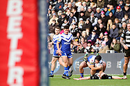 St Helens half back Jonny Lomax (6) looks to play the ball whilst Hull FC outside back Jake Connor (6) is on the floor during the Betfred Super League match between Hull FC and St Helens RFC at Kingston Communications Stadium, Hull, United Kingdom on 16 February 2020.