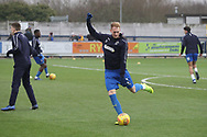 AFC Wimbledon midfielder Mitchell (Mitch) Pinnock (11) warming up during the EFL Sky Bet League 1 match between AFC Wimbledon and Barnsley at the Cherry Red Records Stadium, Kingston, England on 19 January 2019.