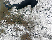 Snow over Poland and its neighbours. True-color Aqua MODIS image from February 25, 2003. MODIS also detected a number of fires in the scene, all of which are marked in red. Countries shown are (clockwise from top left) Denmark, Sweden, Lithuania, the Russi