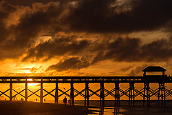 June 5, 2017 - Folly Beach, SC, United States of America - Dawn breaks over the Folly Beach Pier on a cloudy morning June 5, 2017 in Folly Beach, South Carolina. Folly Beach is a quirky beach community outside Charleston known to locals as the Edge of America. (Credit Image: © Richard Ellis via ZUMA Wire)