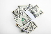 Cutout of a pile of US bank notes on white background