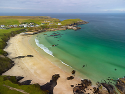 Aerial view from drone of village beach and harbour at Port Ness at northern tip of Isle of Lewis, Outer Hebrides, Scotland, UK