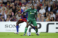 FOOTBALL - CHAMPIONS LEAGUE 2010/2011 - GROUP STAGE - GROUP D - FC BARCELONA v PANATHINAIKOS - 14/09/2010 - PHOTO JEAN MARIE HERVIO / DPPI - DJIBRIL CISSE (PAN) / ERIC ABIDAL (FCB)