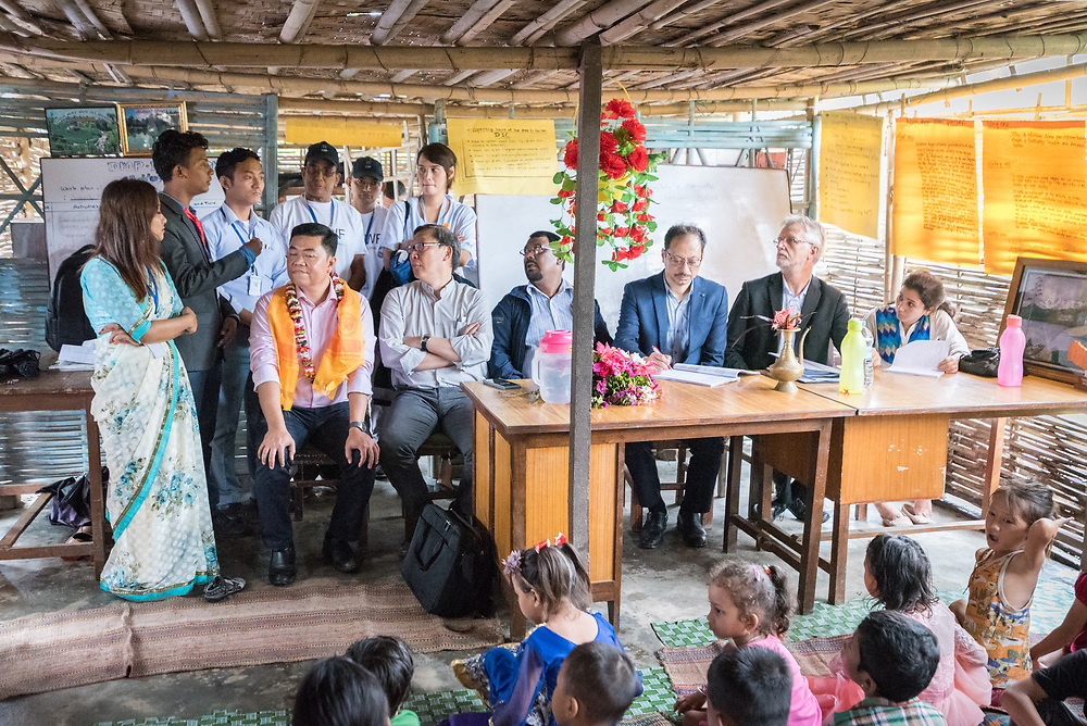 """14 September 2018, Damak, Nepal: """"We need to keep making sure all children go to school,"""" says Bhutanese Refugee Children's Forum chief coordinator Ramchandra Chapagai, as Lutheran World Federation general secretary Rev. Dr Martin Junge visits the forum. Supported by the Lutheran World Federation, the Beldangi refugee camp in the Jhapa district of Nepal hosts more than 5,000 Bhutanese refugees. Here, inside one of the camp's many homes."""