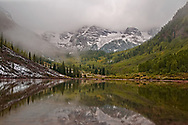 A morning snowstorm covers the Maroon Bells.