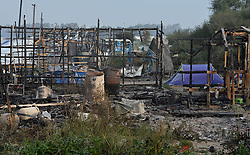 A small part of the near deserted Calais Jungle camp, close to where demolition workers have started work on breaking down living areas of the camp close to Calais in France.