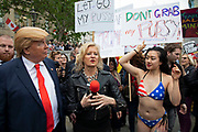 Donald Trump lookalike interacts with a bikini wearing protester who is holding a placard which reads Dont grab my pussy in Trafalgar Square during protests against the state visit of US President Donald Trump on 4th June 2019 in London, United Kingdom. Organisers Together Against Trump which is a collaboration between the Stop Trump Coalition and Stand Up To Trump, have organised a carnival of resistance, a national demonstration to protest against President Trump's policies and politics during his official UK visit.
