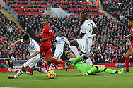 Liverpool Goalkeeper Loris Karius makes a save from Steven Pienaar of Sunderland (l) . Premier League match, Liverpool v Sunderland at the Anfield stadium in Liverpool, Merseyside on Saturday 26th November 2016.<br /> pic by Chris Stading, Andrew Orchard sports photography.