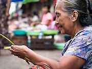 16 JUNE 2013 - YANGON, MYANMAR:  A woman in a market in Yangon. Yangon, formerly Rangoon, is the largest city in Myanmar. It is the former capital of the Southeast Asian country. It's still Myanmar's economic capital.     PHOTO BY JACK KURTZ