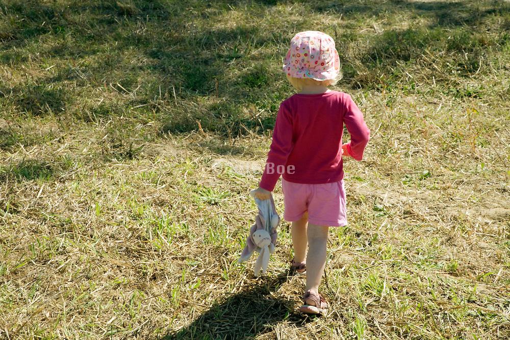 little girl walking away by her self