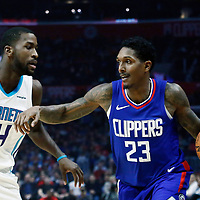 31 December 2017: Charlotte Hornets forward Michael Kidd-Gilchrist (14) defends on LA Clippers guard Lou Williams (23) during the LA Clippers 106-98 victory over the Charlotte Hornets, at the Staples Center, Los Angeles, California, USA.