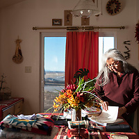 Phoebe Morgan looks through Navajo Housing Authority (NHA) paperwork at her home in the Tse'ii'ahi' NHA Subdivision in Standing Rock, New Mexico Thursday. Morgan and other residents of the subdivision have been trying to meet with NHA to resolve multiple home repair issues.
