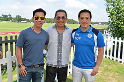 Owner of Leicester City FC Vichai Srivaddhanaprabha and his sons Top & Tip at Cartier Queen's Cup Polo, Guard's Polo Club, Berkshire, England. 18 June 2017.<br /> Photo by Dominic O'Neill/SilverHub 0203 174 1069 sales@silverhubmedia.com