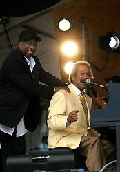 30 April 2006. New Orleans, Louisiana. Jazzfest . <br /> The first New Orleans Jazz and Heritage festival following the disaster of Hurricane Katrina. <br /> Music legend Alan Toussaint is joined by guest star Elvis Costello on the Acura stage.<br /> <br /> Photo ©Charlie Varley/varleypix.com<br /> All rights reserved.