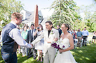 Carrie and Jim were married on the shores of Lobdell Lake, Linden, Michigan. Underneath a weeping will tree, they walked the aisle and said their vows, bridesmaids and groomsmen lined the lakeside. They celebrated as the sunset, with family, friends, and great cheer.