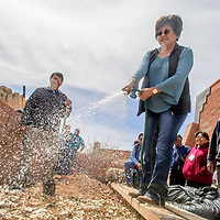 """Yvonne Kee Billison, right, sprays down a """"lasagna bed"""" garden plot during 2018 Diné Bich'iya (Navajo Food Sovereignty) Summit activities at the Navajo Nation Museum in Window Rock Saturday."""