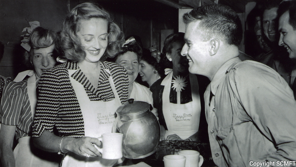 1942 Bette Davis, founder of the Hollywood Canteen, pours coffee at the Stage Door Canteen in New York.