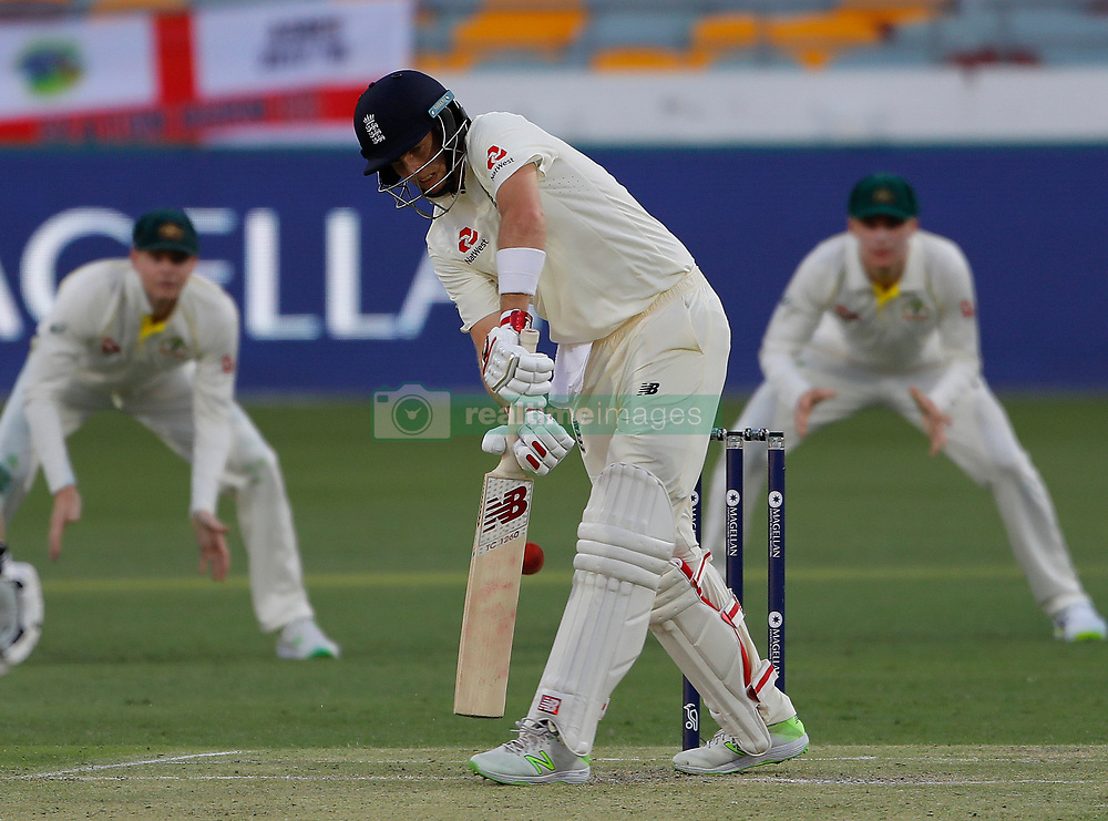 England V Australia at the Gabba. 23 Nov 2017 Pictured: Joe Root out 15 LBW after a successful review by Australia bowled Pat Cummings. Photo credit: MEGA TheMegaAgency.com +1 888 505 6342