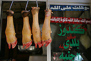Cow hooves and legs hanging outside a butcher shop in Cairo, Egypt. (Supporting image from the project Hungry Planet: What the World Eats.)