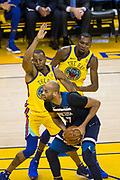 Golden State Warriors forward Andre Iguodala (9) and Golden State Warriors forward Kevin Durant (35) defend the Minnesota Timberwolves at Oracle Arena in Oakland, Calif., on January 25, 2018. (Stan Olszewski/Special to S.F. Examiner)
