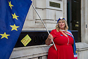 A post it note attached to the Cabinet office  reads To Do- Recall Parliament as  a Anti - Brexit protester demonstrates outside the Cabinet office in Whitehall as Ministers hold a Brexit Cabinet meeting on 19th August 2019 in London, United Kingdom.